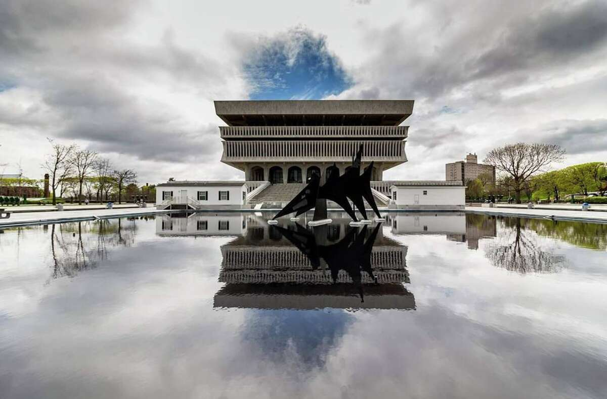 A cloudy sky over the New York State Museum. Photo credit: @thedonhd