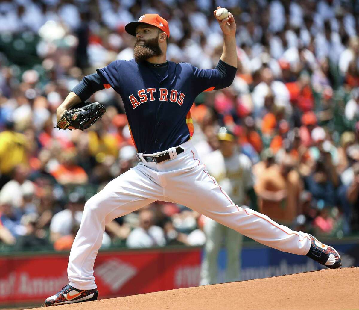Astros starter Dallas Keuchel struck out nine A's in picking up his fifth victory of the season.