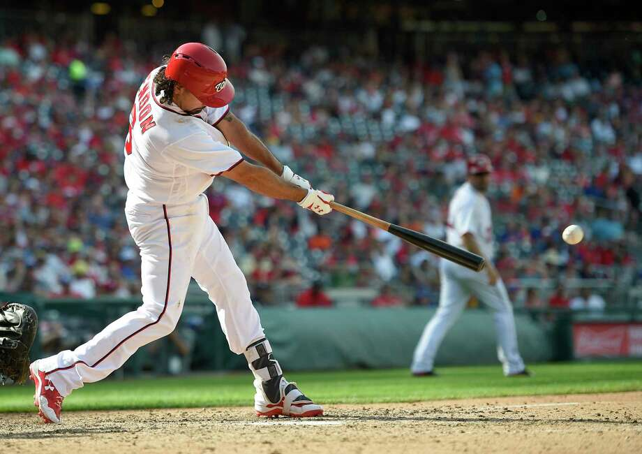 Washington Nationals' Anthony Rendon singles during the seventh inning of a baseball game against the New York Mets, Sunday, April 30, 2017, in Washington. (AP Photo/Nick Wass) ORG XMIT: NAT115 Photo: Nick Wass / FR67404 AP