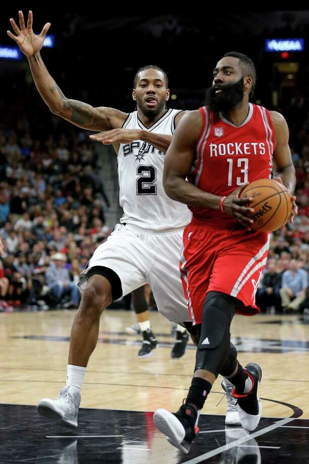 The Spurs' Kawhi Leonard, left, likely will defend the Rockets' James Harden, right, at some point during the best-of-seven Western Conference semifinals. Photo: Edward A. Ornelas, Staff / © 2017 San Antonio Express-News