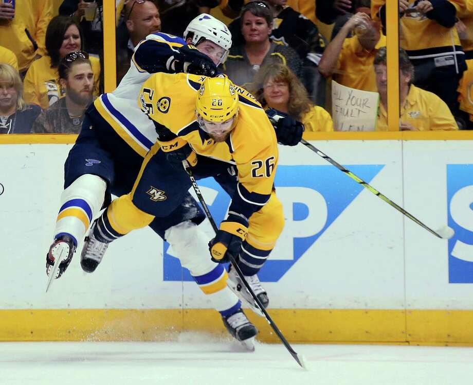 Nashville Predators left wing Harry Zolnierczyk, right, collides with St. Louis Blues defenseman Joel Edmundson in the second period during Game 3 of an NHL hockey playoff series, Sunday, April 30, 2017, at the Bridgestone Arena in Nashville, Tenn. The Predators won 3-1. (Chris Lee/St. Louis Post-Dispatch via AP) ORG XMIT: MOSTP715 Photo: Chris Lee / (c) 2017 St. Louis Post-Dispatch