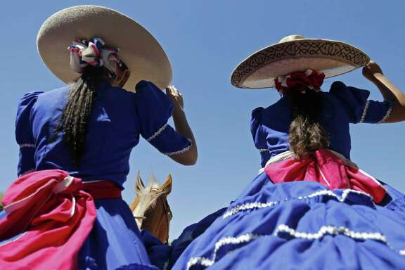 Members of the Escaramuza Las Coronelas salute during the Day in Old Mexico and Charreada held Sunday April 30, 2017 at the San Antonio Charro Ranch.