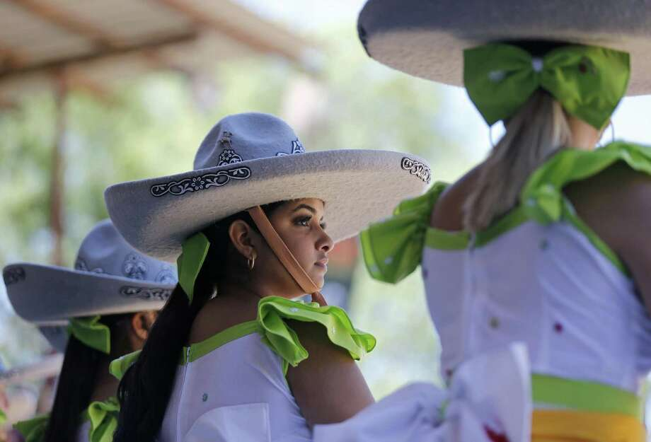 Madelyn Montecillos (center), a member of Escaramuza Herencia Mexicana, takes in the sights during the Day in Old Mexico and Charreada held Sunday April 30, 2017 at the San Antonio Charro Ranch. Photo: Edward A. Ornelas, Staff / San Antonio Express-News / © 2017 San Antonio Express-News