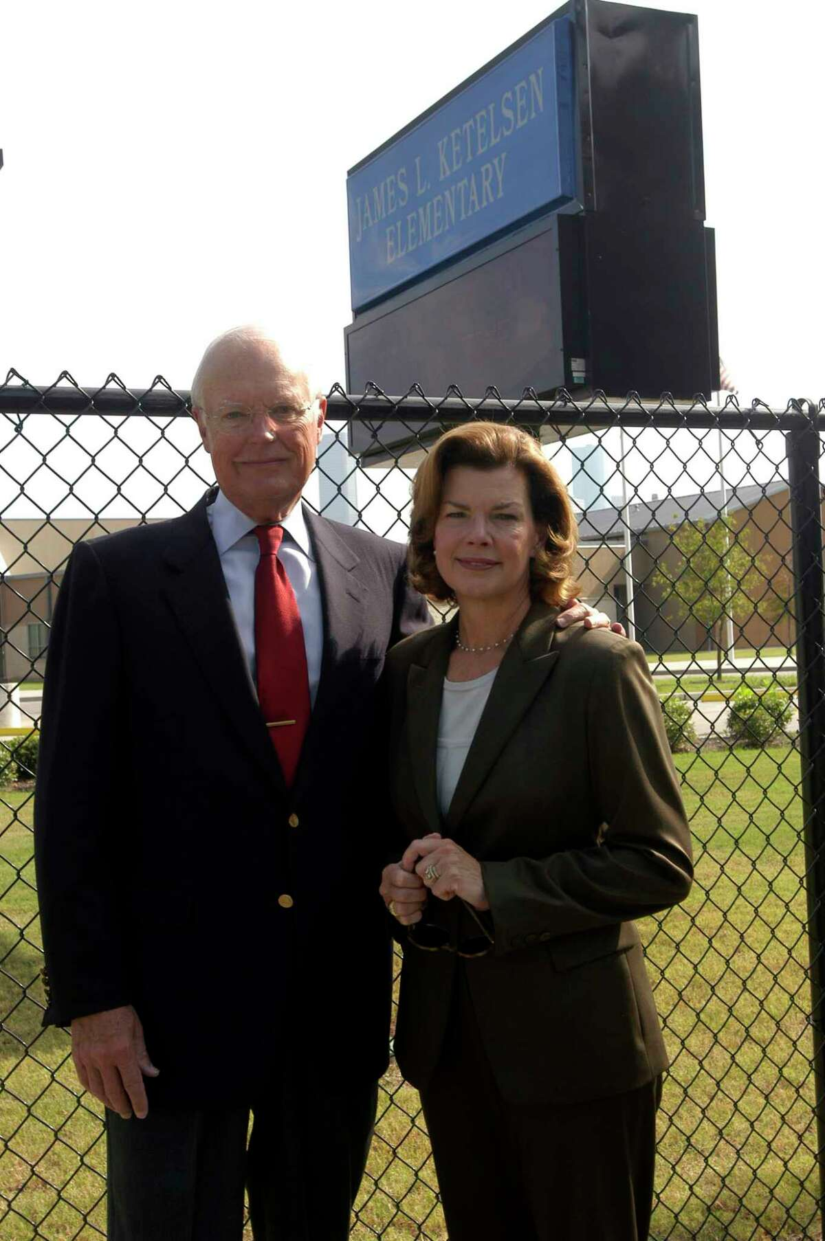 Jim and Kathryn Ketelsen pose in front of the James L. Ketelsen Elementary School sign, 09/25/04. (Photo by Kim Christensen) HOUCHRON CAPTION (10/07/2004) THIS WEEK Z8 Z11 COLORFRONT: Ketelsens work to send more students to college. HOUCHRON CAPTION (10/07/2004) THIS WEEK Z8 Z11: IN HIS NAME: Jim and Kathryn Ketelsen stand in front of the James L. Ketelsen Elementary School, named after Jim. HOUCHRON CAPTION (10/07/2004) THIS WEEK Z10 COLOR: IN HIS NAME: Jim and Kathryn Ketelsen stand in front of the James L. Ketelsen Elementary School, 600 Quitman