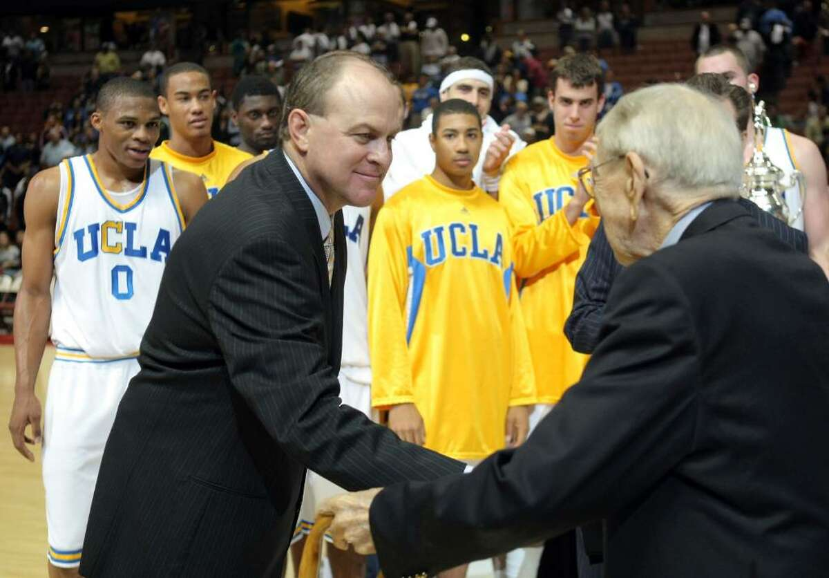 ANAHEIM, CA - DECEMBER 08: Head Coach Ben Howland of the UCLA Bruins shakes hands with John Wooden after a 75-63 win over the Davidson Wildcats during the John Wooden Classic at the Honda Center on December 8, 2007 in Anaheim, California. (Photo by Harry How/Getty Images)