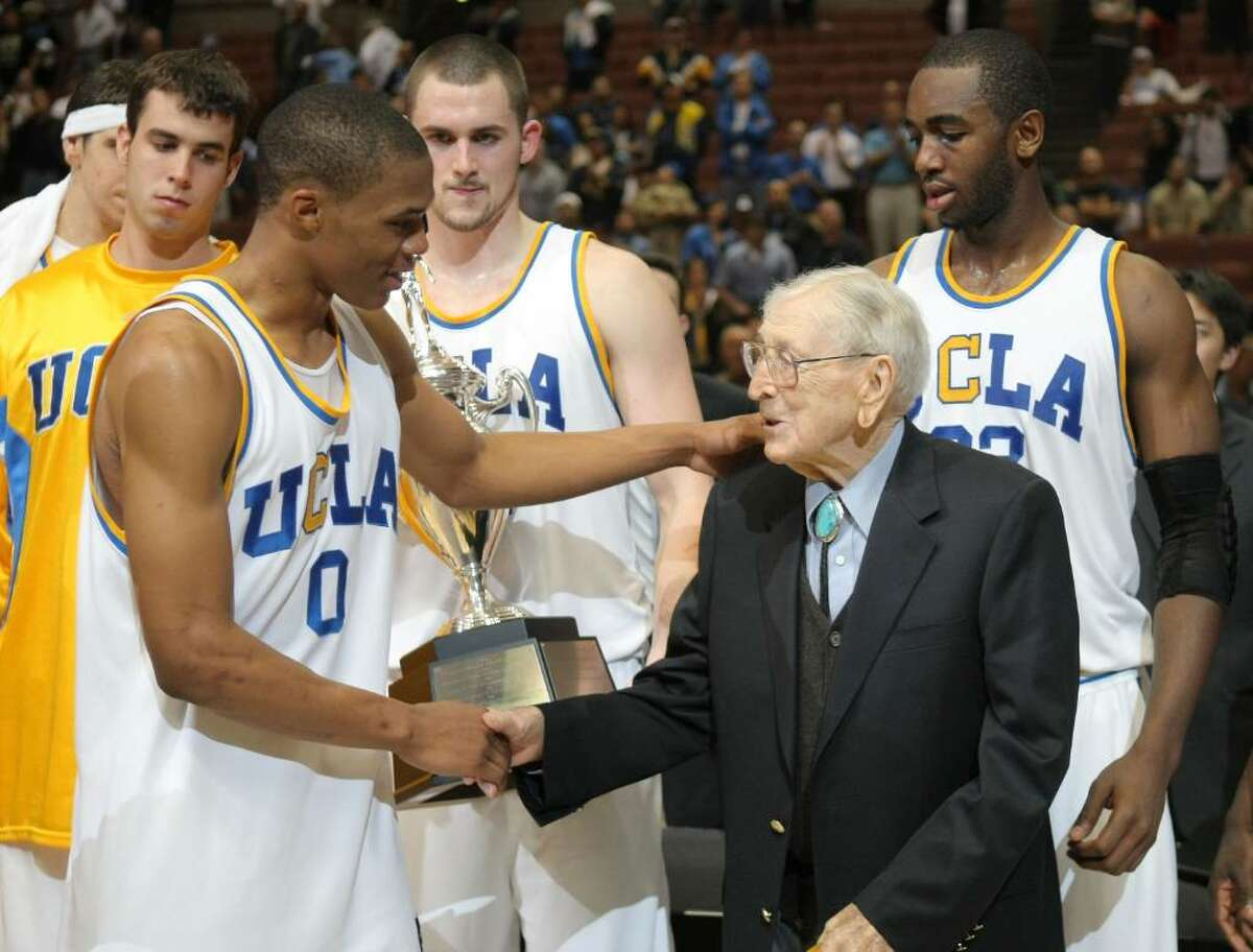 ANAHEIM, CA - DECEMBER 08: Russell Westbrook #0 of the UCLA Bruins shakes hands with John Wooden after a 75-63 win over the Davidson Wildcats during the John Wooden Classic at the Honda Center on December 8, 2007 in Anaheim, California. (Photo by Harry How/Getty Images)