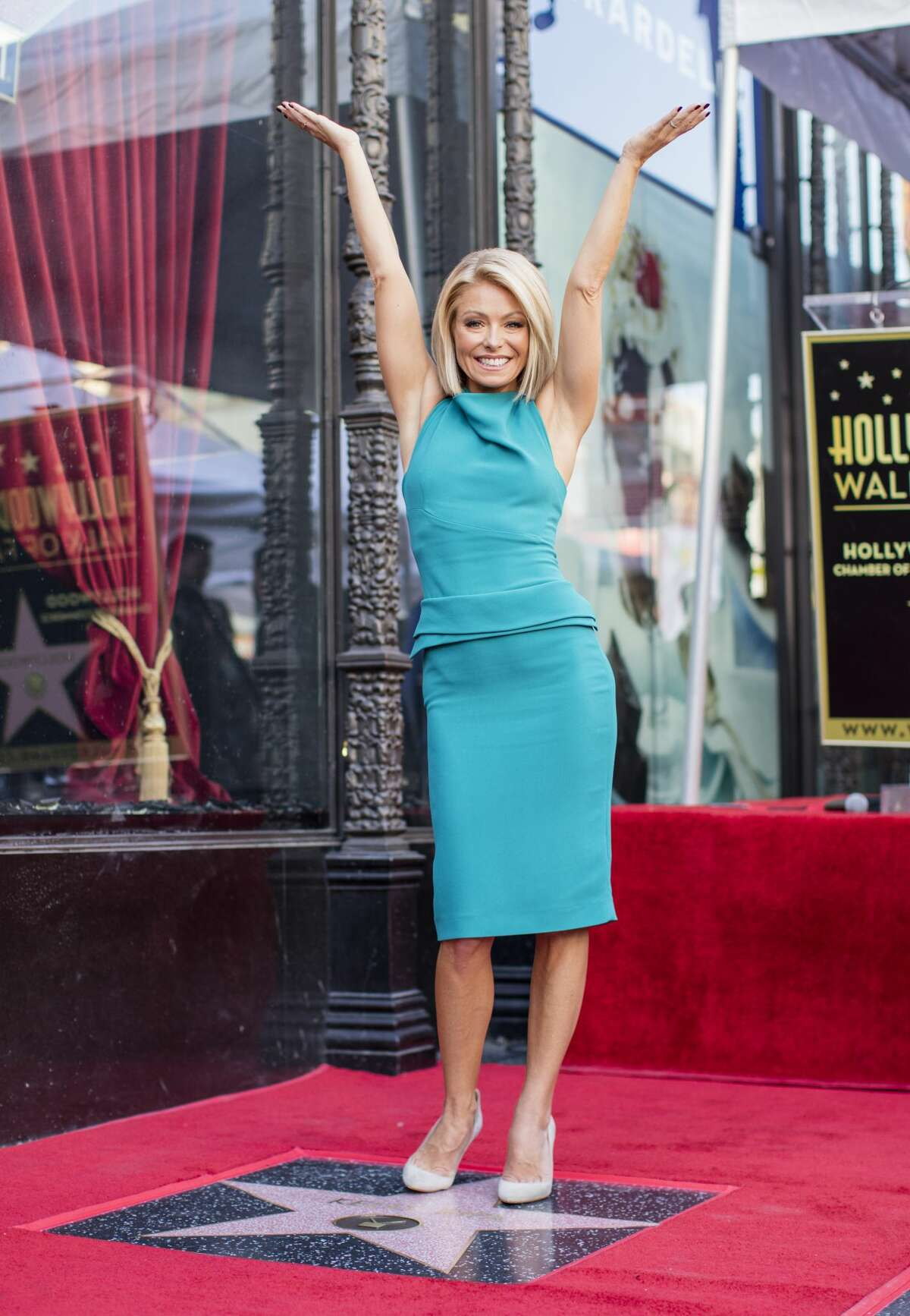 HOLLYWOOD, CA - OCTOBER 12: Television host Kelly Ripa poses with her star on the Hollywood Walk of Fame on October 12, 2015 in Hollywood, California. (Photo by Mark Davis/Getty Images)