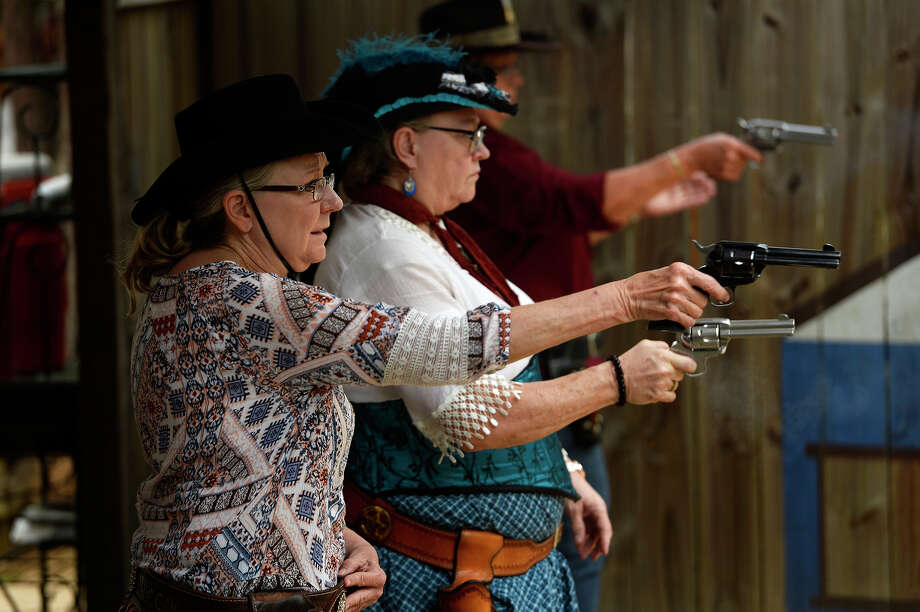 Women compete at the Texas State Cowboy Fast Draw Competition at Camp Waluta near Silsbee on Friday. Competitors dress in Wild West attire and compete to see who can draw and fire their pistols the quickest.  Photo taken Friday 4/28/17 Ryan Pelham/The Enterprise Photo: Ryan Pelham, Ryan Pelham/The Enterprise / ©2017 The Beaumont Enterprise/Ryan Pelham