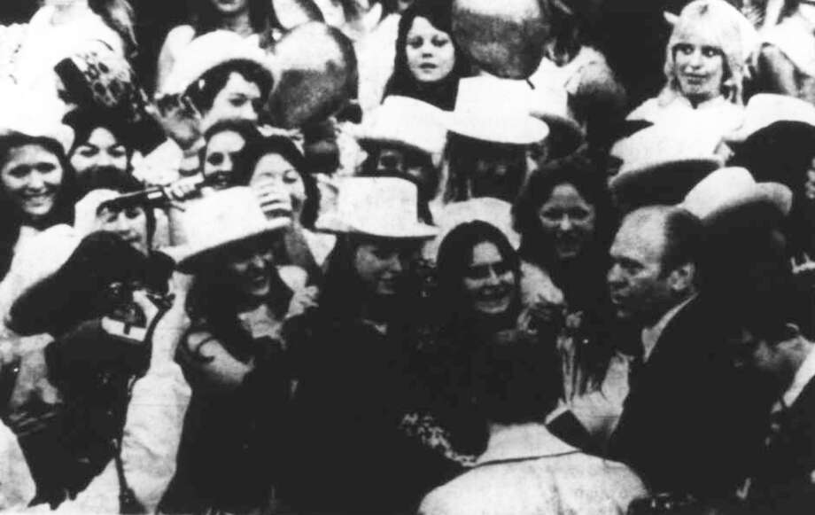 Members of the Golden Girls dance team at Conroe High School meet President Gerald Ford.