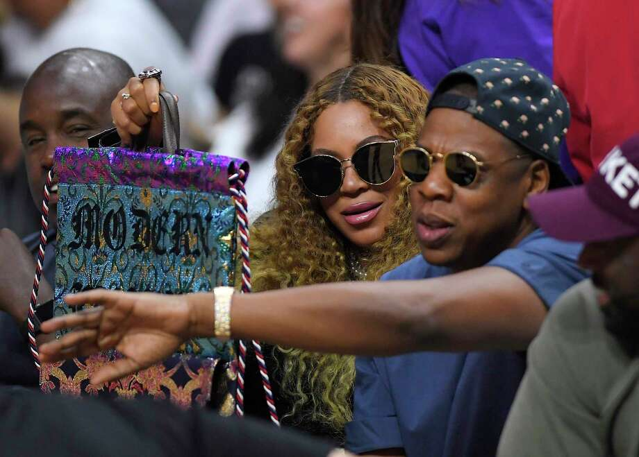 Beyonce and Jay Z watch during the first half in Game 7 of an NBA basketball first-round playoff series between the Los Angeles Clippers and the Utah Jazz, Sunday, April 30, 2017, in Los Angeles. (AP Photo/Mark J. Terrill) Photo: Mark J. Terrill, Associated Press / Copyright 2017 The Associated Press. All rights reserved.