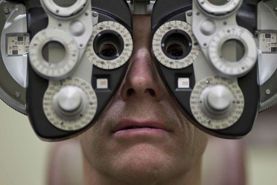 The state legislature is mulling a bill that would limit online eye exams for people who use contact lenses. Photo: Smiley N. Pool / Houston Chronicle / © 2011  Houston Chronicle