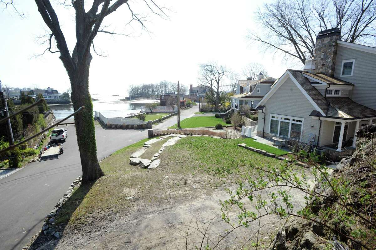 The African-American Cemetery, at center to the left of the home at 11 Byram Dock St. in the Byram section of Greenwich. The African-American Cemetery is adjacent to the Old Burying Ground at Byram Shore and the Lyon cemetery.