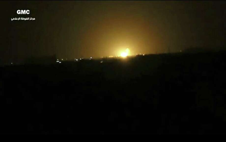 This frame grab from video provided by the Syrian anti-government activist group Ghouta Media Center, which has been authenticated based on its contents and other AP reporting, shows flames rising after an explosion near an airport west of Damascus, Syria, Thursday, April 27, 2017. Syria's state media reported Thursday that Israel has attacked a military installation near the Damascus International Airport. SANA says Israel fired several missiles from inside the occupied Golan Heights south of the capital at a military installation near the capital's main airport, triggering several explosions and causing damage. (Ghouta Media Center via AP) Photo: Uncredited, HONS / Associated Press / Ghouta Media Center