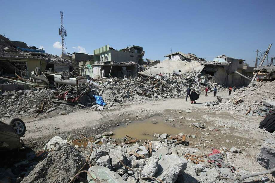 """(FILES) This file photo taken on March 26, 2017 shows Iraqis inspecting the rubble of destroyed houses in the Mosul al-Jadida area, following air strikes in which civilians have been reportedly killed during an ongoing offensive against the Islamic State (IS) group.   US-led strikes aimed against the Islamic State group have """"unintentionally"""" killed 352 civilians since the offensive began in 2014, according to the US military. The tally from the Combined Joint Task Force did not include findings from an investigation the coalition said it had launched into one allegedly particularly deadly strike on March 17 in west Mosul.US General Stephen Townsend had said coalition forces """"probably had a role in those casualties.""""The statement released April 30, 2017 by Operation Inherent Resolve -- the coalition fighting the Islamic State group in Iraq and Syria -- said 42 reports of civilian fatalities were still under review.   / AFP PHOTO / AHMAD AL-RUBAYEAHMAD AL-RUBAYE/AFP/Getty Images Photo: AHMAD AL-RUBAYE, Staff / AFP/Getty Images / AFP or licensors"""