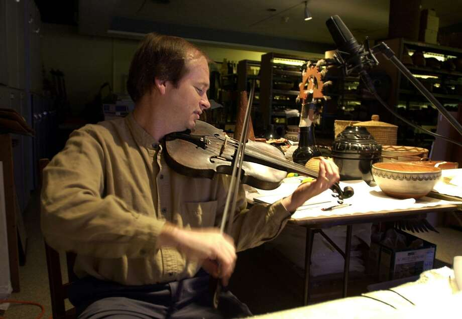 Dean Shostak records a song using what was called Davy Crockett's fiddle Sept. 26, 2001, at the Witte Museum. Photo: Express-News File Photo / SAN ANTONIO EXPRESS-NEWS