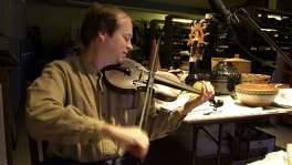 Dean Shostak records a song using what was called Davy Crockett's fiddle Sept. 26, 2001, at the Witte Museum.