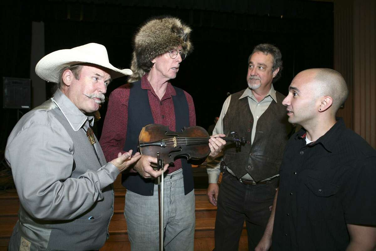 K.R. Wood (CD producer), Mike Fowler (fiddle player holding what was called Crockett's fiddle), T Gosney Thornton (singer) and Rene Gonzales (Witte Museum registrar) were at the Witte Museum on Aug. 17, 2007, for the Davy Crockett 221st Birthday Party and Performance.