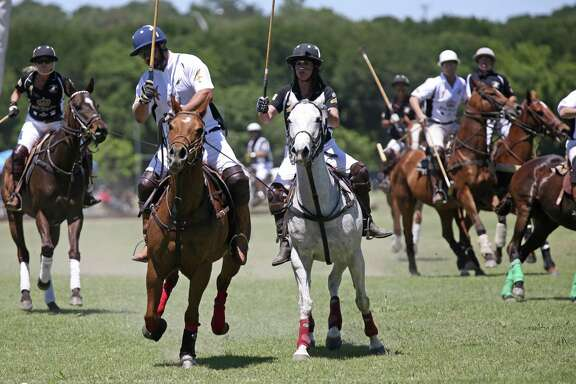 Team King Antonio Ursula Pari MacLeod, (center right) goes up against Team Austin's Ron Horne during the San Antonio Polo Club's Fiesta King Cup at Olmos Basin Park in 2017.