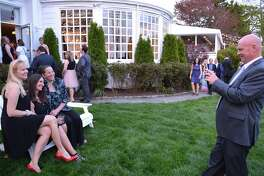 Posing for a photo by Bill Nealon, of Westport, are, from right, his wife, Val Saltzman, Susy Evans and Suzanna Cundari, both of Norwalk. Russ Lowder and Ashley Dineen, both of Darien, share a laugh