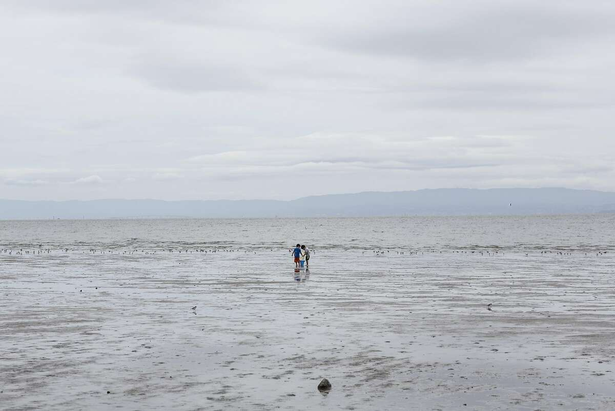 File photo - Two children play at the Robert W. Crown Memorial State Beach in Alameda, Calif., on Saturday, April 22, 2017.