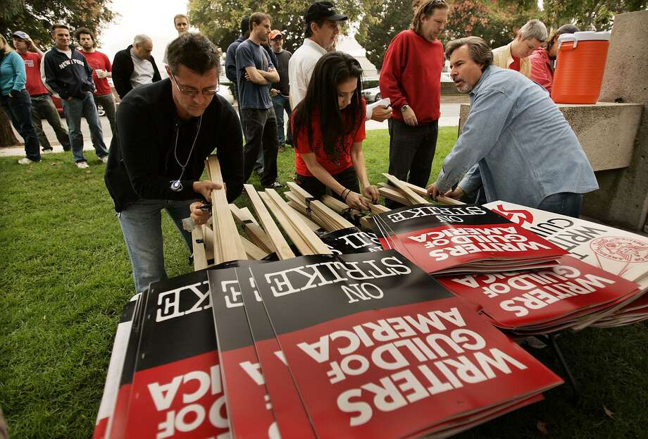 Writer's Guild staffers prepare signs to distribute for a picket around the NBC Studios in Burbank, Calif., during the start of the 2007 strike. That strike halted productions on numerous shows, led to a shortened television season and even affected major film releases. Photo: Los Angeles Times File Photo / Los Angeles Times