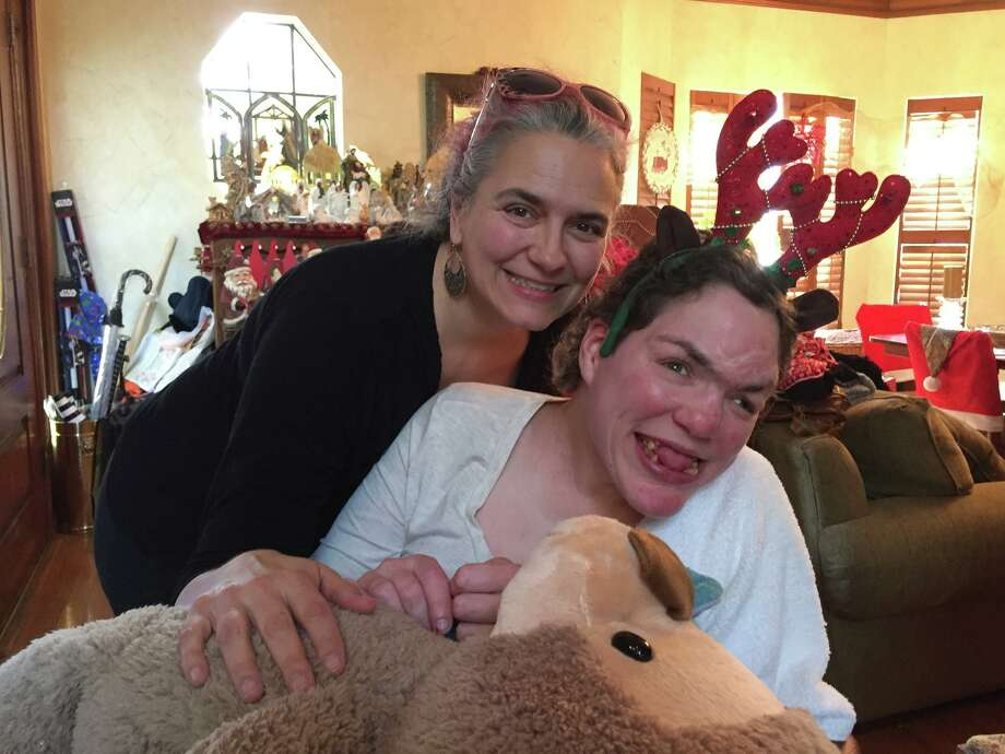 A Sunset Commission recommended in 2015 that the State Supported Living Center in Austin be closed. In this photo: The writer Liz Belile with her sister, Shanna, who lives in the Austin SSLC. Photo: Liz Belile
