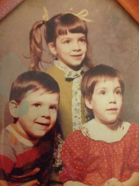 Belile with her twin siblings. Shanna, on the lower right, would be diagnosed with Lennox Gastaut Syndrome. Photo: Liz Belile