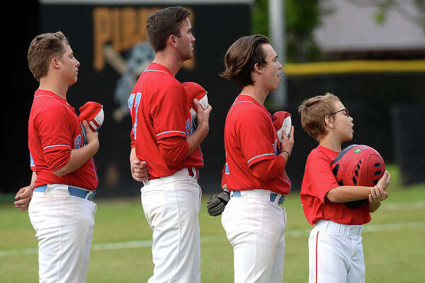 Lumberton's players line up to observe the National Anthem during their match-up in Vidor Tuesday. Each team is vying to secure a spot in the District 22-5A playoff. Vidor is currently tied with Nederland, while Lumberton is tied for second with Livingston heading into the final games of the regular season. Photo taken Tuesday, April 25, 2017 Kim Brent/The Enterprise