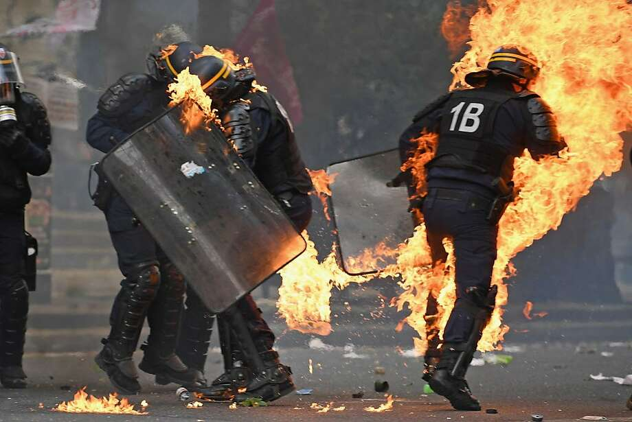 Demonstrators confront police on the annual May Day worker's march on May 1, 2017 in Paris, France. Police dealt with violent scenes in central Paris during the rally held close to the Place de la Bastille, where protestors shouted 'Fascists out!' Photo: Jeff J Mitchell, Getty Images
