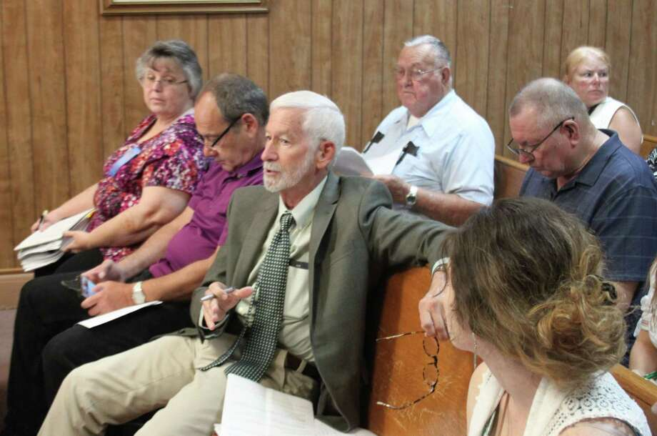 David Waxman (middle) of Waxman and Associates explains the situation regarding the change orders and the usage of funds for the Coldspring Community Shelter project during the April 25 San Jacinto County Commissioners Court. Photo: Jacob McAdams