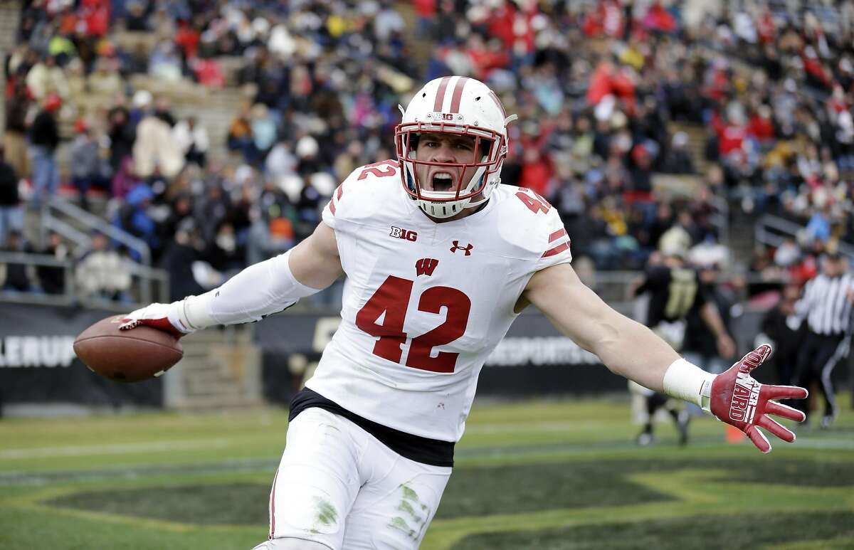 Wisconsin linebacker T.J. Watt (42) celebrates after returning an interception for a touchdown during the first half of an NCAA college football game against the Purdue in West Lafayette, Ind., Saturday, Nov. 19, 2016. (AP Photo/Michael Conroy)