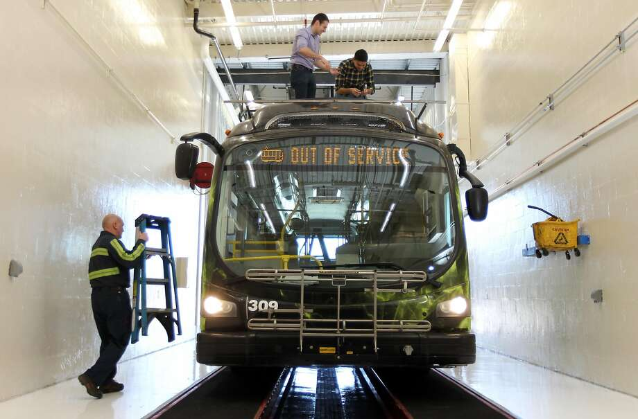 Workers at University of Nevada, Reno install a string of cameras on top of Proterra electric bus. The Burlingame company is counting on sensors and high-definition cameras like the one below to gather data during its test on Nevada streets. Photo: Lance Iversen, San Francisco Chronicle