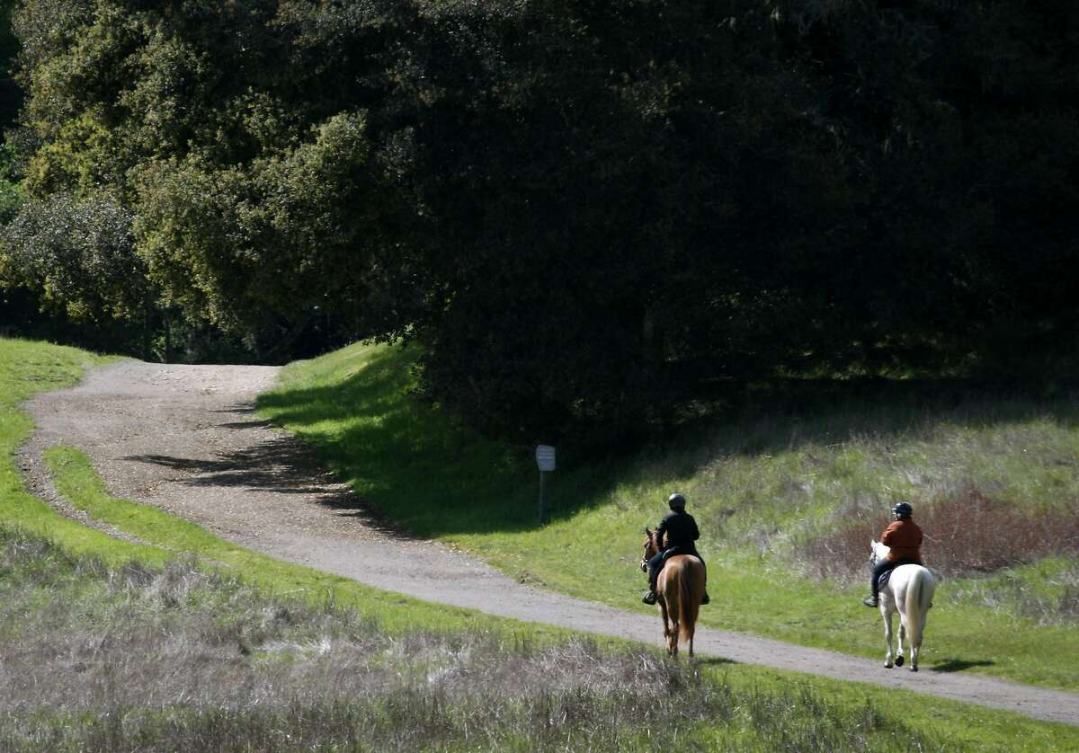 Two equestrians head out for a sunny day of riding on the Bear Valley Trail at Point Reyes National Seashore in Point Reyes, Calif., on Thursday, April 1, 2010.