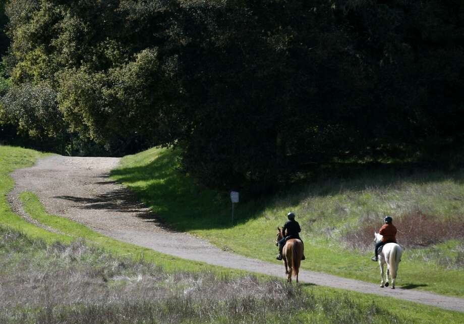 Two equestrians head out for a sunny day of riding on the Bear Valley Trail at Point Reyes National Seashore in Point Reyes. Photo: Paul Chinn, The Chronicle
