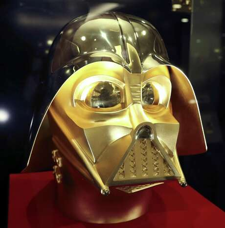 The gold mask of Darth Vader in a glass case is displayed at Tokyo gold jeweler Ginza Tanaka's shop in Tokyo. The life-size mask of Star Wars villain Darth Vader will be up for sale for a hefty price of $1.4 million. Photo: Koji Sasahara /Associated Press / Copyright 2017 The Associated Press. All rights reserved.