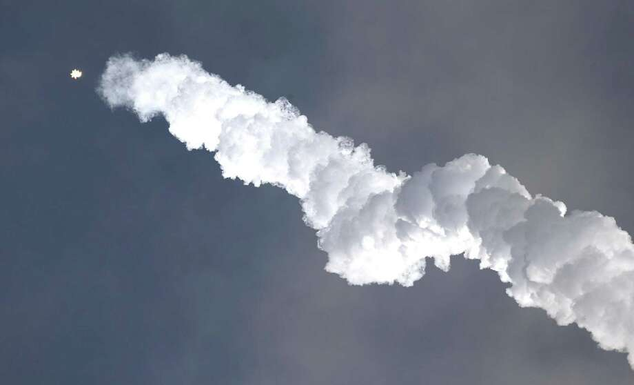 A Falcon 9 SpaceX rocket carrying a classified satellite for the National Reconnaissance Office lifts off Monday from pad 39A at the Kennedy Space Center in Cape Canaveral, Fla. Photo: John Raoux /Associated Press / Copyright 2017 The Associated Press. All rights reserved.