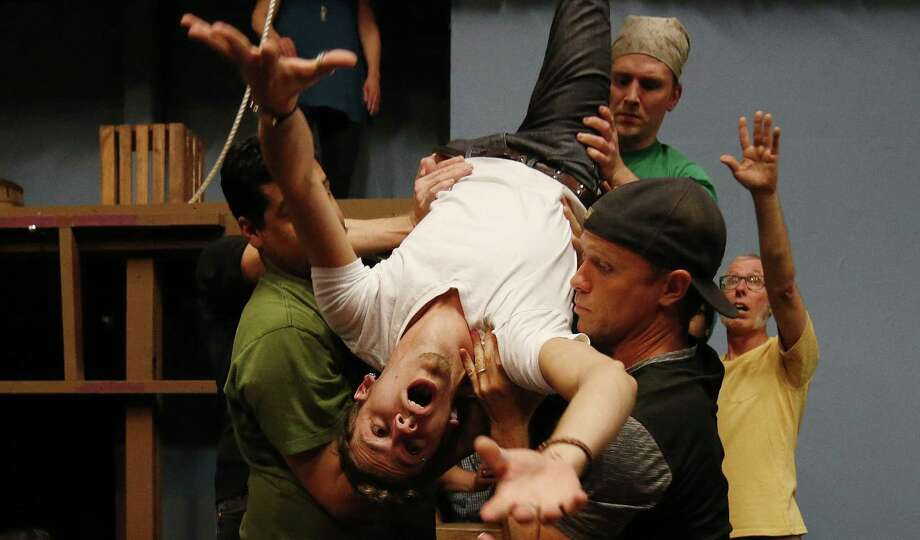 "Actor Kailyr Frazier (center) and the cast of ""Peter and the Starcatcher"" rehearse a scene. The Sheldon Vexler Theatre's staging of ""Peter and the Starcatcher,"" directed by the husband and wife team of Ken Frazier and Tami Kai, will include some acrobatic movements. Photo: Kin Man Hui /San Antonio Express-News / ©2017 San Antonio Express-News"