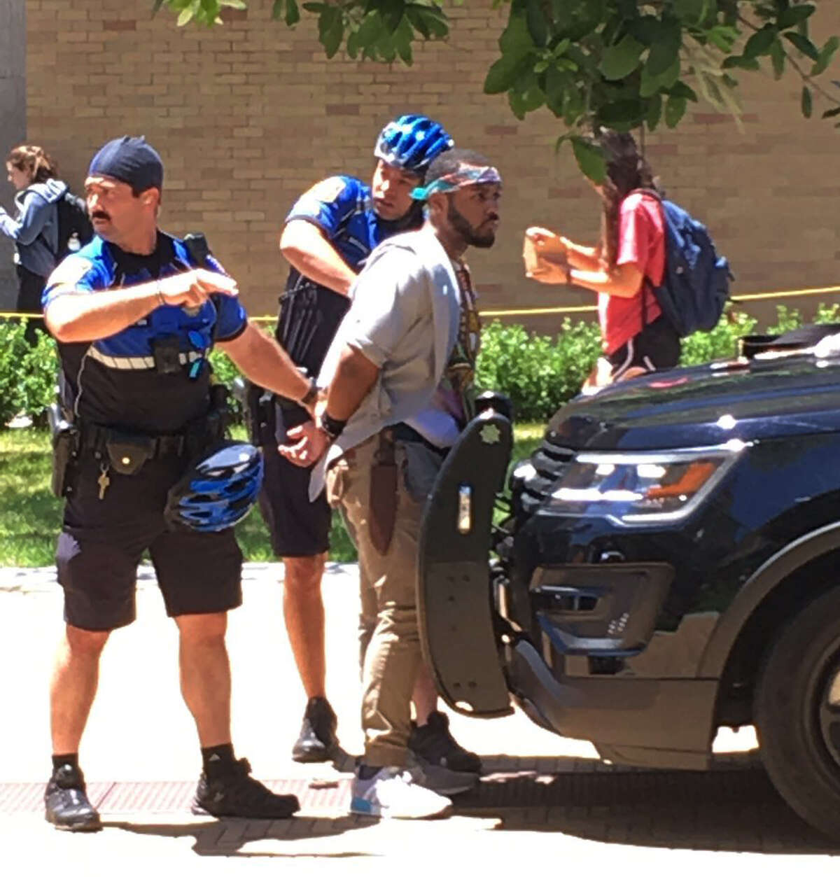 A man is arrested after a fatal stabbing attack on the University of Texas campus in Austin, Texas, Monday, May 1, 2017. Police later named the suspect as Kendrex J. White.