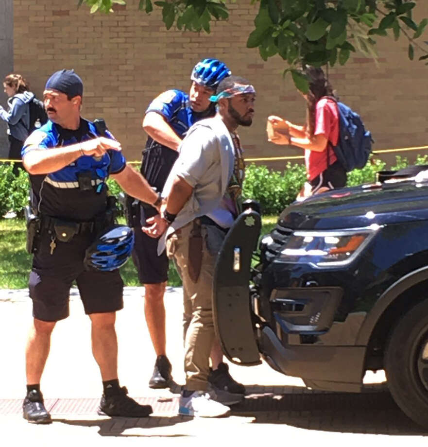 A man is arrested after a fatal stabbing attack on the University of Texas campus in Austin, Texas, Monday, May 1, 2017. Police later named the suspect as Kendrex J. White. Photo: Ray Arredondo‏