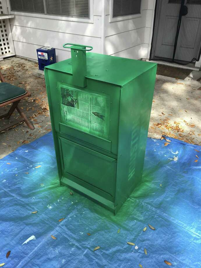 Girl Scout Troop 20309 will install a Free Little Library at  The School at St. George Place on Saturday, May 6. These photos show the process of decorating the library, which was once a Houston Chronicle newspaper stand. Photo: Troop 20309