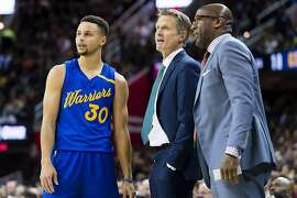 CLEVELAND, OH - DECEMBER 25: Stephen Curry #30 of the Golden State Warriors talks to head coach Steve Kerr of the Golden State Warriors and assistant coach Mike Brown during the first half against the Cleveland Cavaliers at Quicken Loans Arena on December 25, 2016 in Cleveland, Ohio. NOTE TO USER: User expressly acknowledges and agrees that, by downloading and/or using this photograph, user is consenting to the terms and conditions of the Getty Images License Agreement. Mandatory copyright notice. (Photo by Jason Miller/Getty Images)