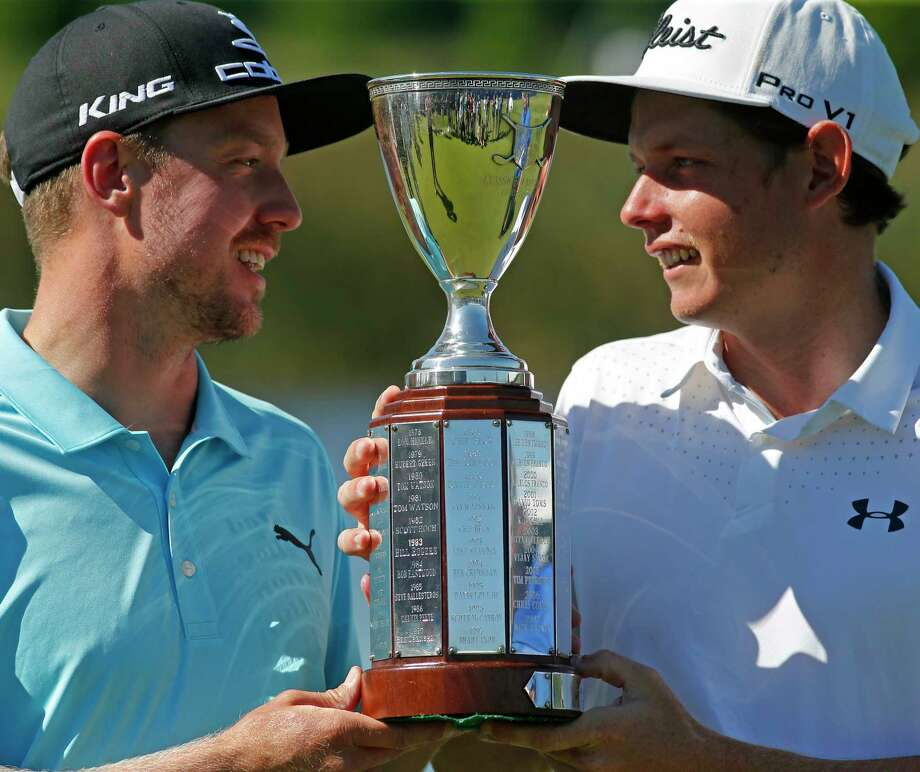 Jonas Blixt, of Sweden, left, and teammate Cameron Smith, of Australia, hold up their tournament trophy after they won a sudden-death playoff for the PGA Zurich Classic golf tournament's new two-man team format at TPC Louisiana in Avondale, La., Monday, May 1, 2017. The pair defeated Kevin Kisner and Scott Brown. (AP Photo/Gerald Herbert) Photo: Gerald Herbert, STF / Copyright 2017 The Associated Press. All rights reserved.