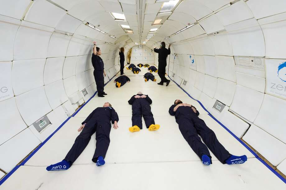 We laid down on the floor as the plane rapidly ascended, creating the experience of increased gravity, about twice the normal amount. Photo: Al Powers/ZERO-G