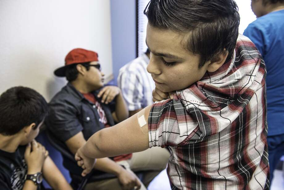 Only half of American boys have received the HPV vaccine. In this photo: A 12-year-old boy receives the vaccine at Amistad Community Health Center in Corpus Christi, Texas.