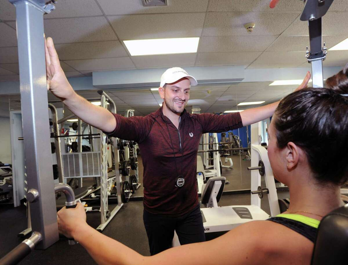 """Anel Dzafic, the founder of Countdown Fitness, trains client Lauren Argenti at Rick Stebbins Performance Therapy Center in Greenwich on Friday. Dzafic is senior personal trainer who favors a """"slow burn method"""" when it comes to weight-training part of working out."""