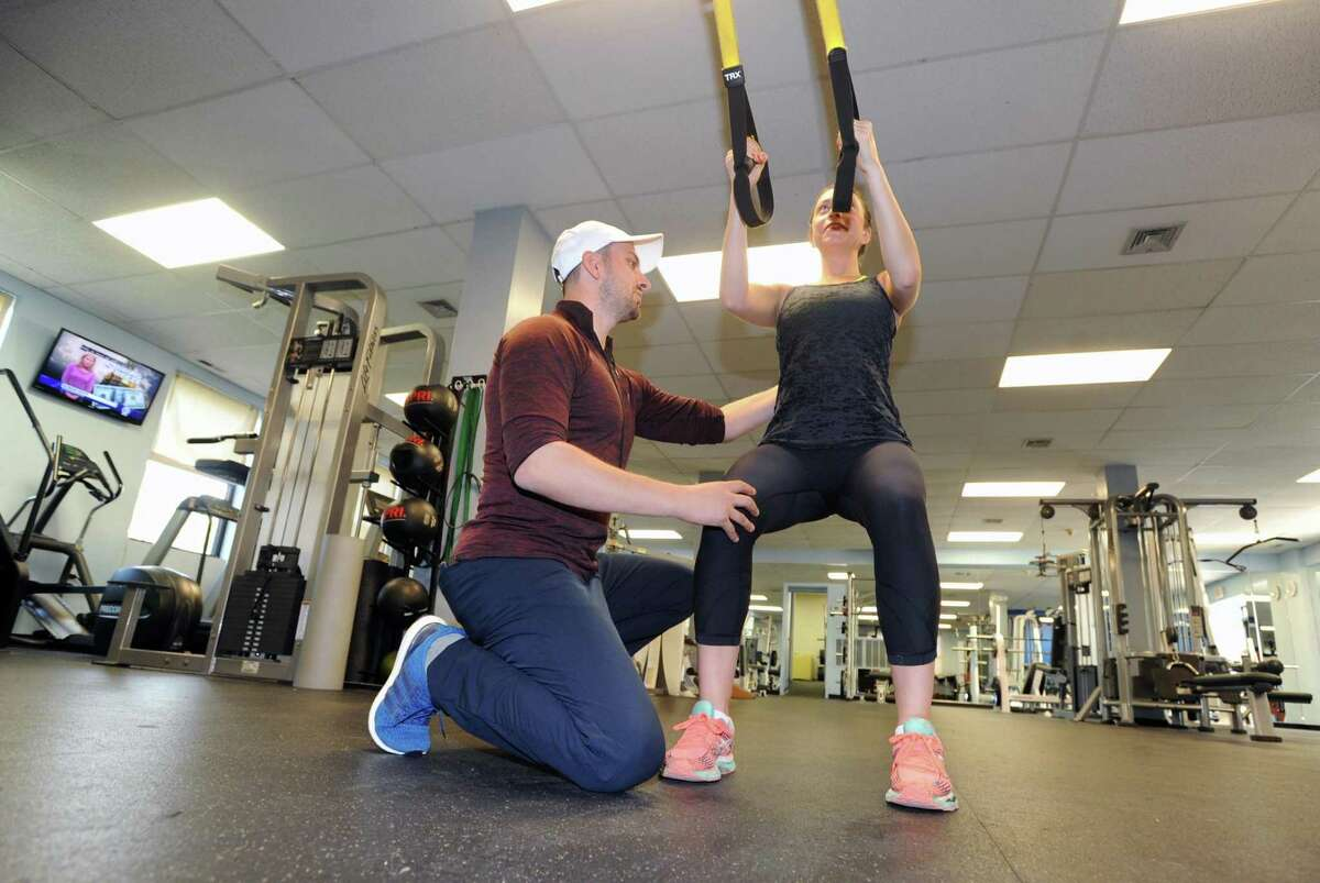 At left, Anel Dzafic, the founder of Countdown Fitness, works-out client Lauren Argenti at Rick Stebbins Performance Therapy Center in Greenwich, Conn., Friday night, April 28, 2017. Dzaficwill open his own studio at 409 Greenwich Ave. in September 2018.