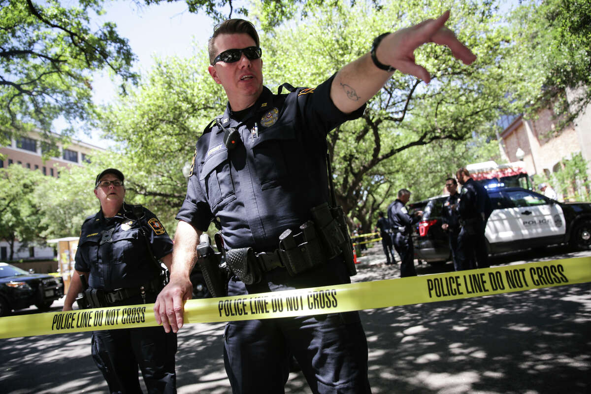 Law enforcement officers secure the scene after a fatal stabbing attack on the University of Texas campus Monday, May, 1, 2017.