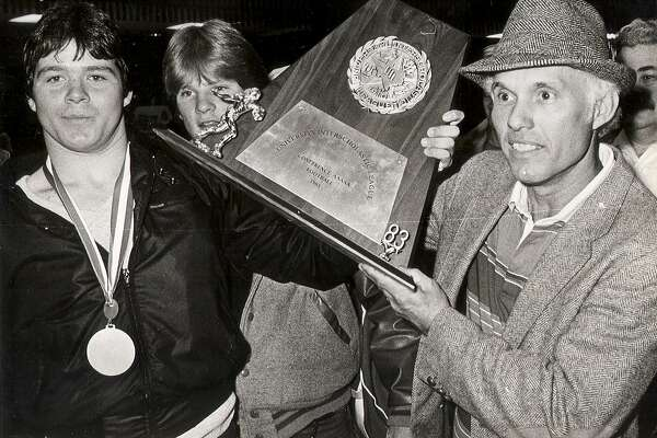 Frank Arnold, who was in his fourth and final season as Judson's coach, shows off the Class 5A state title trophy the Rockets won in 1983.