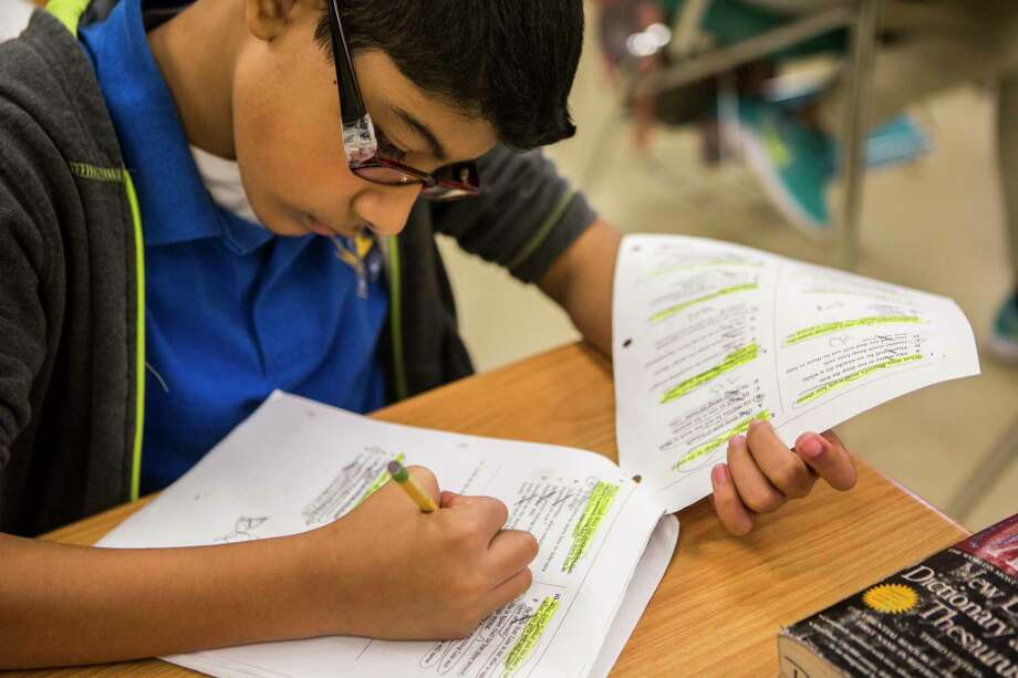 David Torres, a sixth grade student at Houston Gateway Academy reviews material in preparation for the State of Texas Assessments of Academic Readiness (STAAR), Monday, May 1, 2017, in Houston. Photo: Marie D. De Jesus, Houston Chronicle / © 2017 Houston Chronicle