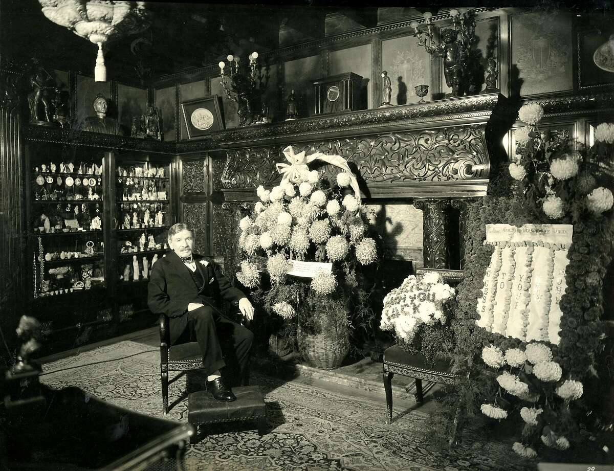 M.H. de Young, proprietor and publisher of the Chronicle, in his famous office, in the new San Francisco Chronicle building at 5th and Mission streets in 1924. He is seated with congratulatory flowers presented to him by Chronicle employees and civic organizations. De Young's office appears precisely as it did in the old location at Market and Kearny streets. All of the beautiful woodwork and fittings of his old office were moved to the new location and installed in a room built to the exact dimensions of the former one. It was said that no one could tell that it had been moved. Photo by Gabriel Moulin Studio